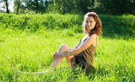 Brunette model laying in meadow Stock Images
