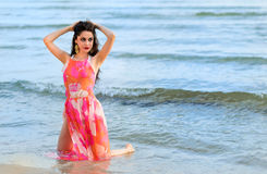 Brunette model photo posing on Swedish beach. Young brunette woman on the summer beach Royalty Free Stock Photo