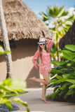 Brunette model poses in a tropical resort Stock Photography