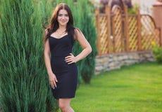 Brunette model posing in black dress. Brunette model posing in short black dress Royalty Free Stock Image