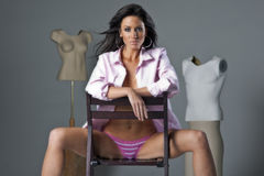 Brunette Model Sitting on Chair Royalty Free Stock Images
