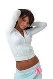 Brunette model in sportswear. Sexy brunette model in sportswear isolated over white Royalty Free Stock Photos