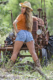Brunette Model With a Tractor Royalty Free Stock Images