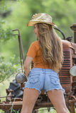Brunette Model With a Tractor Royalty Free Stock Photo