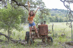 Brunette Model With a Tractor Stock Photos