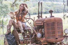 Brunette Model With a Tractor Stock Photo