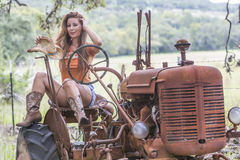 Brunette Model With a Tractor Stock Image