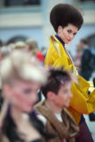 Brunette model with unusual hairstyle. MOSCOW - OCTOBER 2: Brunette model with unusual hairstyle wear yellow kimono at XVII International Festival World of Stock Photo