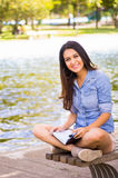 Brunette model wearing denim shirt and white Stock Photo