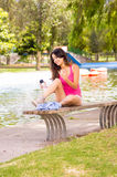 Brunette model wearing pink top and white shorts Royalty Free Stock Image