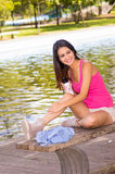 Brunette model wearing pink top and white shorts Stock Image
