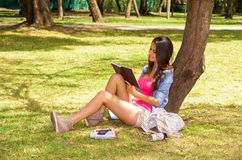 Brunette model wearing pink top and white shorts Stock Photography