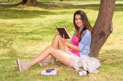 Brunette model wearing pink top and white shorts Stock Photo