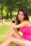 Brunette model wearing pink top and white shorts Royalty Free Stock Photography