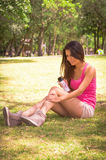 Brunette model wearing pink top and white shorts Royalty Free Stock Images