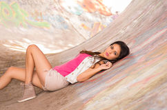 Brunette model wearing pink top, white vest and Royalty Free Stock Photos