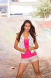 Brunette model wearing pink top, white vest and Stock Photo