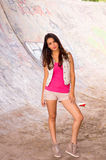 Brunette model wearing pink top, white vest and Royalty Free Stock Images