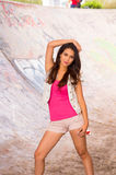 Brunette model wearing pink top, white vest and Stock Photography