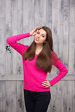 Brunette model woman in sweater in studio Stock Photo