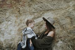 Brunette mom with her cute daughter stock images