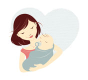 Brunette mother and baby. Brunette mother holding baby in front of a heart Stock Photos