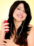 Brunette with music player Stock Photo
