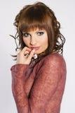 Brunette na cor-de-rosa Imagem de Stock Royalty Free