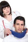 Brunette nurse with patient Stock Images