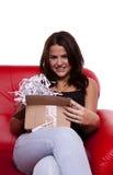 Brunette opening a parcel. Stock Image
