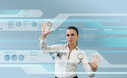Brunette operating interface on the wall royalty free stock images