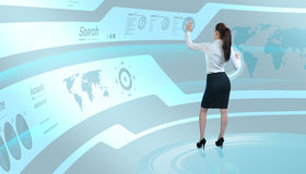 Brunette operating search interface on the wall royalty free stock images