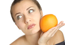 Brunette with orange Royalty Free Stock Photography