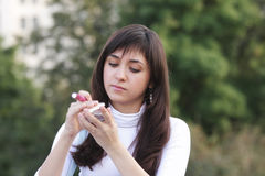Brunette outdoors with makeup set Royalty Free Stock Photos