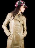 Brunette in overcoat Stock Photos