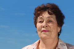 Brunette pensioner woman outdoor Royalty Free Stock Photography