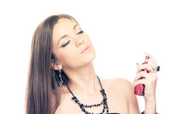 Brunette with perfume Royalty Free Stock Photo