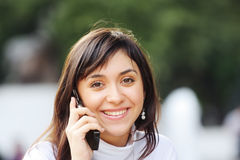 Brunette with phone Stock Image