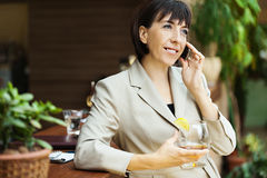 Brunette phone glass Royalty Free Stock Photography