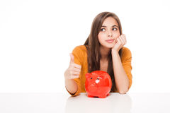 Brunette with piggy bank. Stock Images