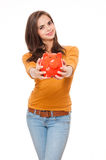 Brunette with piggy bank. Royalty Free Stock Photography