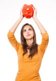 Brunette with piggy bank. Stock Photos