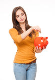Brunette with piggy bank. Stock Photo