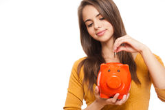 Brunette with piggy bank. Stock Image