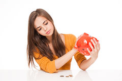 Brunette with piggy bank. Stock Photography