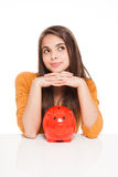 Brunette with piggy bank. Royalty Free Stock Photos