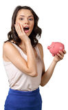 Brunette with piggy bank Royalty Free Stock Photo