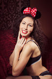 Brunette pin up model posing dressed in underwear and bow of  Mi Stock Photography