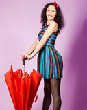Brunette pin up model posing wearing striped dress Stock Photo
