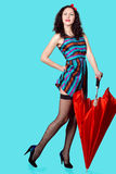 Brunette pin up model posing wearing striped dress Royalty Free Stock Photography